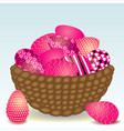beautiful basket with easter eggs on the grass vector image