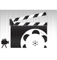black movie clapperboard and camera icon vector image vector image