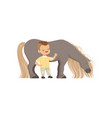 cute smiling little boy standing next pony horse vector image