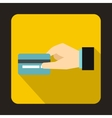 Hand holding a credit card icon flat style vector image