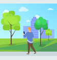 person walking in park with phone leisure vector image vector image