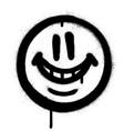 graffiti whimsical smile emojo sprayed in black vector image vector image