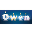 OWEN written with burning candles vector image vector image