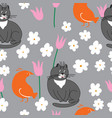 Grey cat and orange bird with flowers