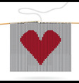 Knitted heart on needles vector image vector image