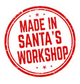 made in santas workshop sign or stamp vector image vector image