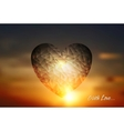 Heart geometric shape on sunset sky vector image