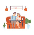 man and a woman are sitting on a sofa at a table vector image vector image