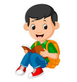 kids boy reading book vector image vector image