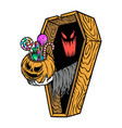 ghost gives candy from inside coffin vector image