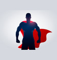 silhouette superhero in strong pose with cape vector image vector image
