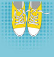pair of shoes on color background in pop art style vector image vector image