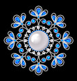 An a shiny pendant brooch with precious stones