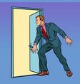 businessman opens door vector image