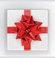 white square gift box with red ribbon and bow red vector image