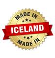 made in Iceland gold badge with red ribbon vector image vector image
