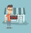 caucasian shop owner holding open signboard vector image vector image