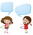 two girls playing hulahoops vector image vector image