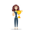 happy young woman with the winners cup vector image