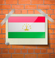 Flags Tajikistan scotch taped to a red brick wall vector image
