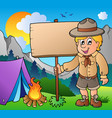 scout boy holding board outdoor vector image