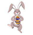 easter bunny with happy expression on face holding vector image vector image