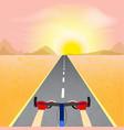 cyclist riding through a desert landscape towards vector image vector image