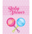 blue and pink toy rattles baby shower card vector image vector image