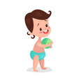 cute little boy wearing diaper playing with a ball vector image