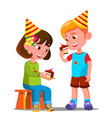 happy children eating a birthday cake vector image vector image