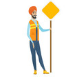 young hindu road worker showing road sign vector image vector image