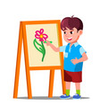 little boy draws on paper with colored pencils vector image