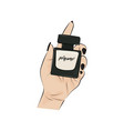 perfume bottle in hand closeup aroma vector image vector image