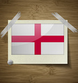 Flags England at frame on wooden texture vector image