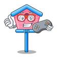 gamer wooden bird house on a pole cartoon vector image