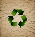 Green recycle symbol on crumpled cardboard vector image