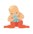 adorable baby sitting and playing with octopus vector image vector image