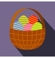 Colorful easter eggs in the basket flat icon vector image vector image