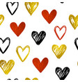 pattern with golden and red hearts vector image