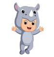 cute boy cartoon wearing rhinoceros costume vector image