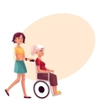 Young woman strolling grandmother in wheelchair