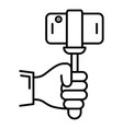 smartphone in selfie stick icon outline style vector image