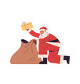 santa claus packing presents gift boxes in sack vector image