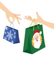 woman hand holding christmas shopping bag vector image vector image