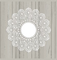 lace style mandala on a wooden background vector image vector image