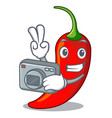 photographer hot chili pepper on cartoon table vector image