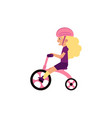 little girl riding tricycle - cute female child vector image vector image