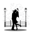 Silhouette of a young couple kissing on street vector image