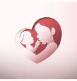 mother holding a baby in heart shaped silhouette vector image vector image