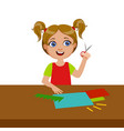 girl cutting grass shape for applique elementary vector image vector image